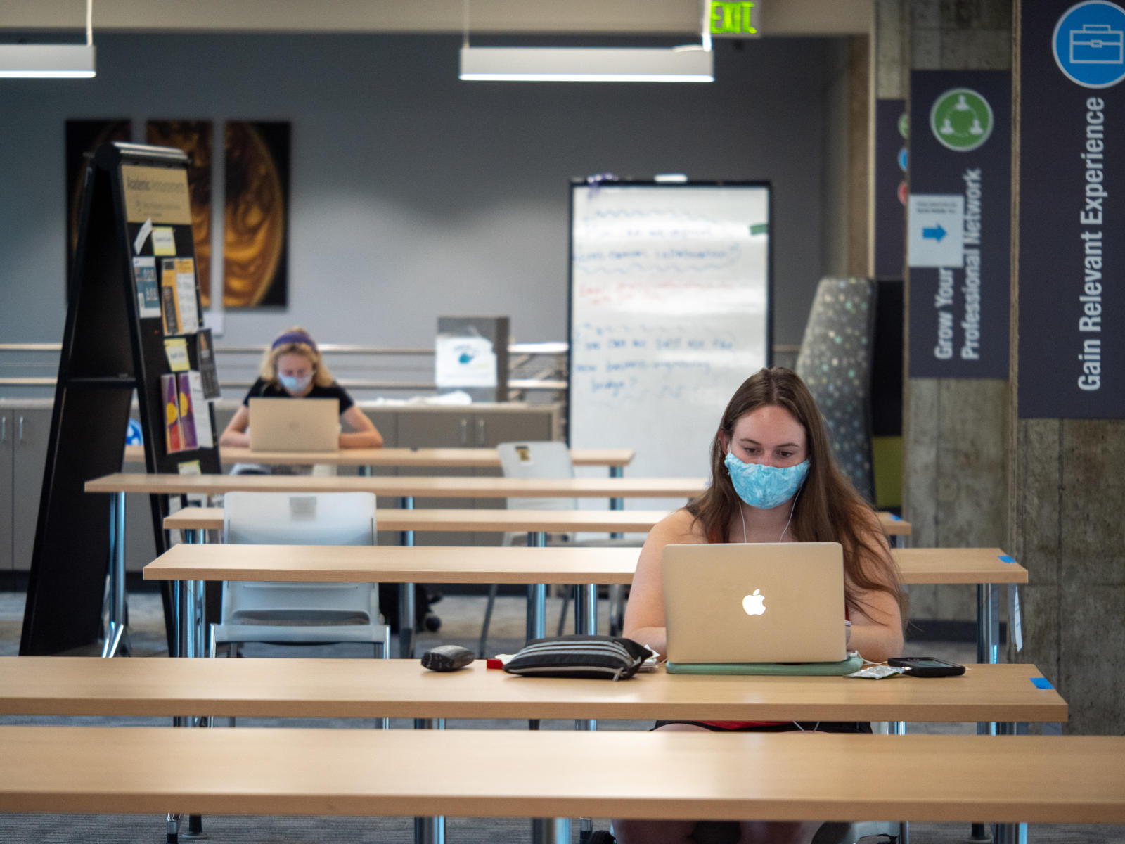 students on computers on campus