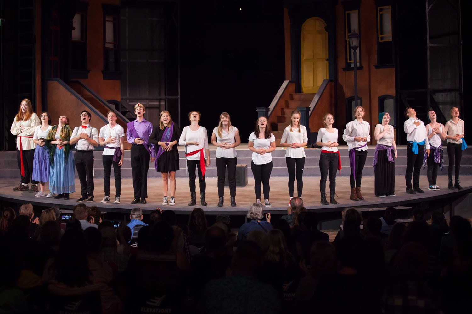 Students perform Kinsmen on stage