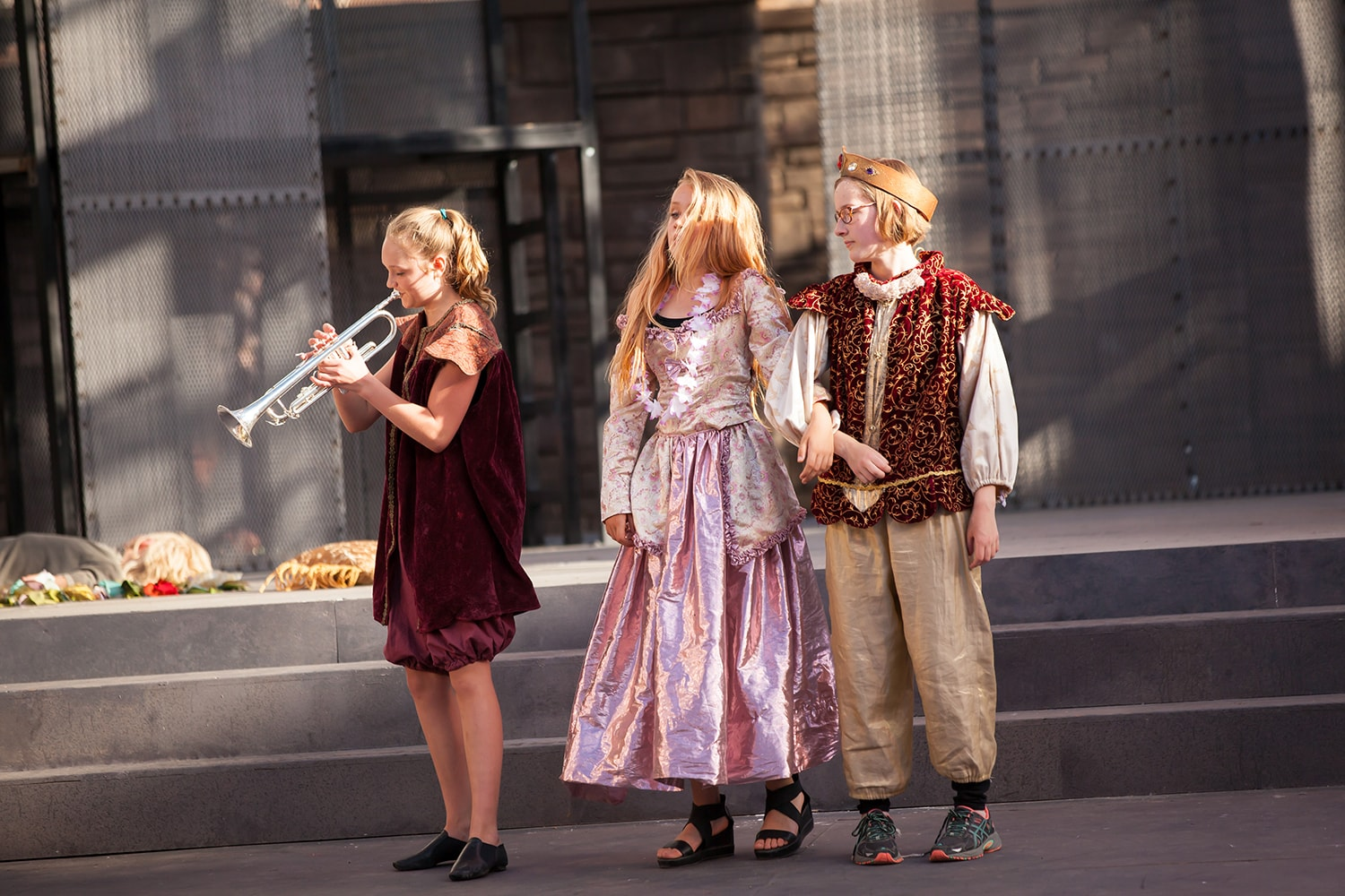 Kids performing Shakespeare on stage