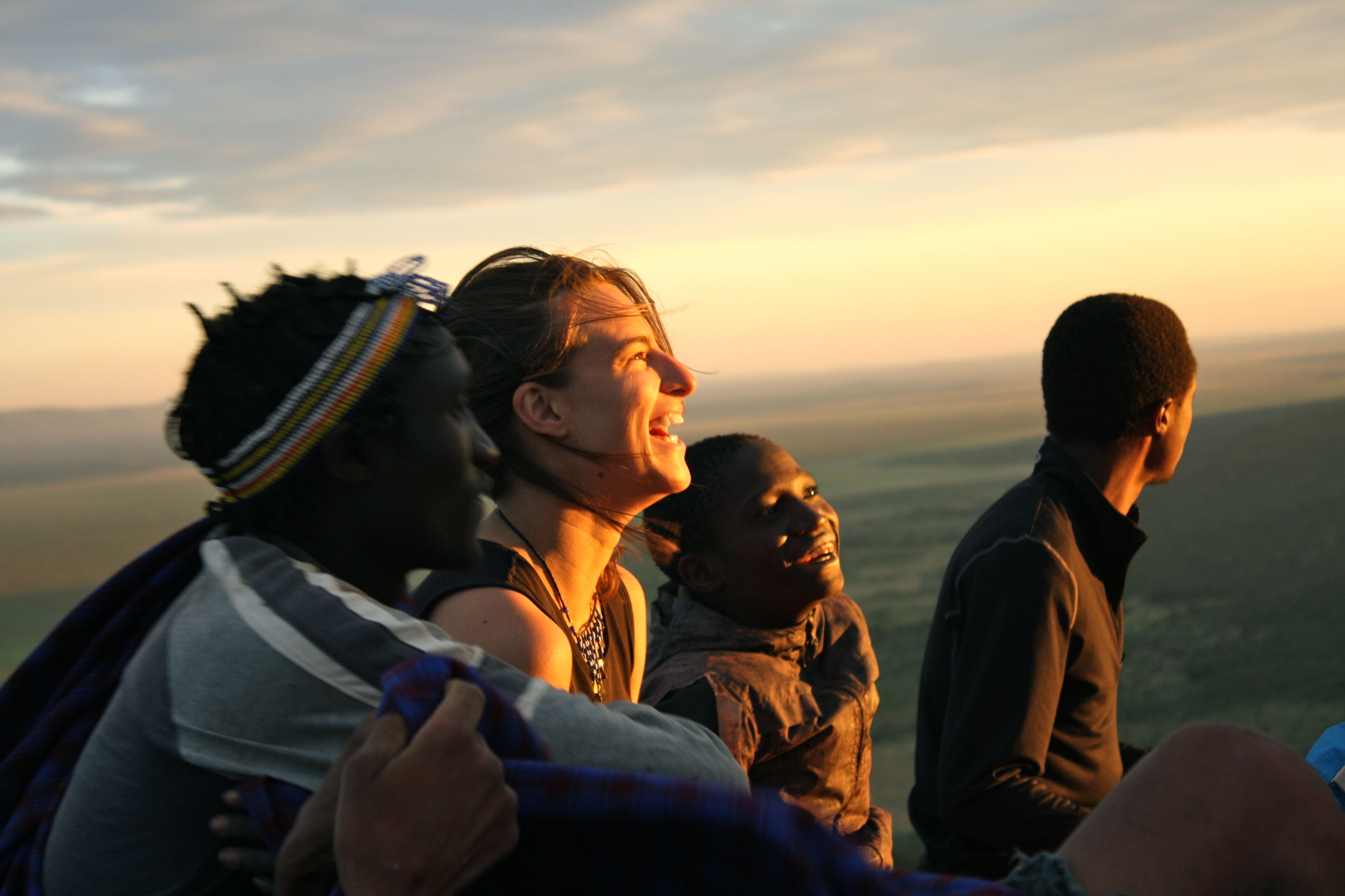 Students and locals watching sunset in Tanzania
